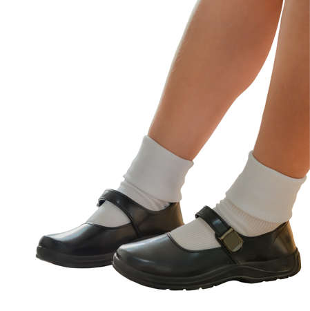 socks child: Thai girls wear a black leather shoes as a school uniform. This is an isolation of shoes and legs.