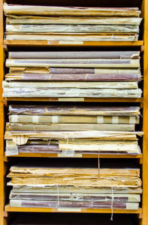 thesis: stack of old worn out books and documents pile up together in Thailand library Editorial