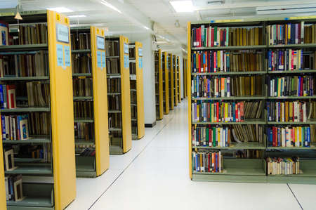 thesis: Row of bookself in a public library of Thammasat University, Thailand
