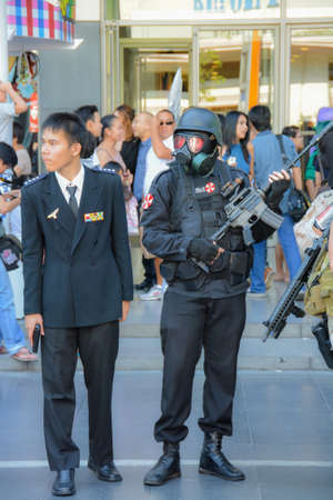 civilians: BANGKOK, THAILAND - MARCH 31: Special force of Umbrella Corporation and his general among civilians in 3rd Thai-Japan anime festival on March 31, 2013.  Editorial