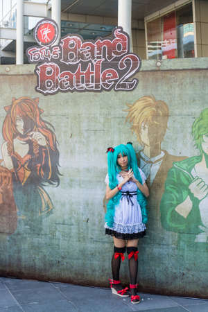 BANGKOK, THAILAND - MARCH 31: Thai Miku cosplayer promotes Band Battle Concert festival on March 31, 2013. Miku is a famous Japanese vocaloid character.