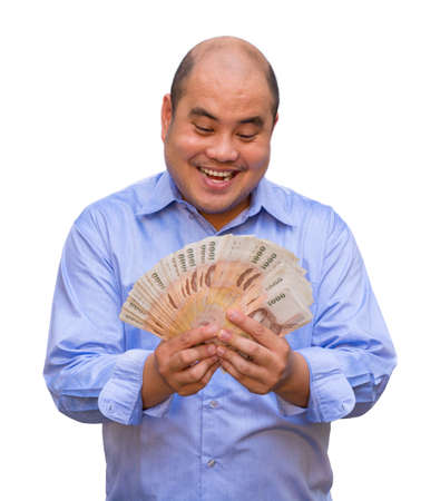 An office guy holding pile of Thai banknotes with his face sweating  It photo
