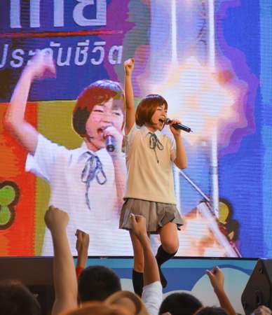 BANGKOK, THAILAND - MARCH 31: Kazumi from Sony Music performs live concert in school uniform in the 3rd Thai-Japan Anime & Music Festival on March 31, 2013. Stock Photo - 18833045
