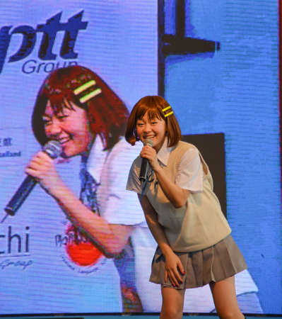 BANGKOK, THAILAND - MARCH 31: Kazumi from Sony Music performs live concert in school uniform in the 3rd Thai-Japan Anime & Music Festival on March 31, 2013. Stock Photo - 18833033