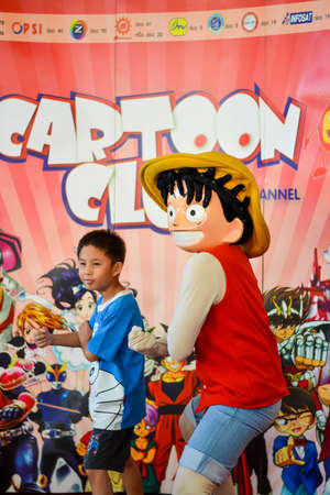 BANGKOK, THAILAND - MARCH 31: Thai kid duplicates Luffys move in the 3rd Thai-Japan anime festival on March 31, 2013. Luffy is a famous international Japanese manga and anime character from One Piece.