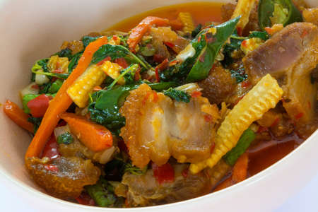 vegtables: Crispy streaky pork with chilli & Basil leaves with various vegtables, eat with rice. Its a traditional Thai cuisine for eveyone in the country.