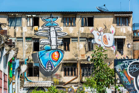 Giant graffiti on the abandon building in Thailand, shoot in public street Stock Photo - 19010998