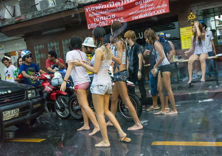 striping: BANGKOK, THAILAND  - 12 APRIL 2013: Wild chicks and transvestite blocking cars on street in Songkran on April 12, 2013. Songkran is a festival which people can splash water freely in Thailand.