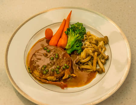 french cuisine: Filet Mignon with gravy sauce on dish. Its a French cuisine