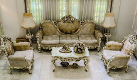 Upper angle of a living room with a luxurious and classical haunting style  photo