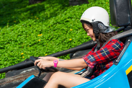 Cute Thai girl is driving Go-kart with speed Stock Photo - 19587848