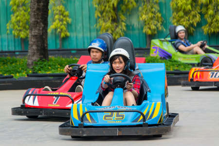BANGKOK, THAILAND - 10 MAY 2013: Thai go-kart racing at Dream World on May 10, 2013. Dream world is a famous amusement park in Thailand.