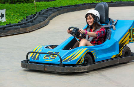 Cute Thai girl is driving Go-kart with speed