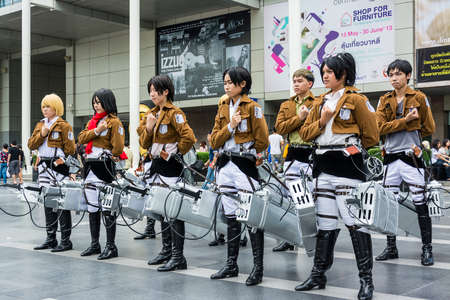 BANGKOK, THAILAND - MAY 25: Thai cosplayer team dress as the characters from Attack on Titan in Oishi World Cosplay Fantastic 7 on May 25, 2013. Attack on Titan is a famous animation in Japan of the year 2013. Stock Photo - 19777298