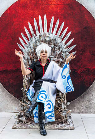 BANGKOK, THAILAND - MAY 25: Thai cosplayer dresses and poses as Sakata Gintoki from Gintama in Oishi World Cosplay Fantastic 7 on May 25, 2013. Gintama is a famous comedy animation in Japan. Editorial