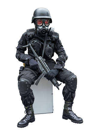 swat: Special force soldier wearing gask mask sitting in isolation background