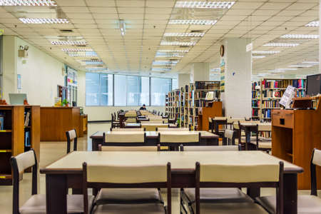 library student: 3nd floor library interior of Chulalongkorn University, the oldest university of Thailand located in Bangkok.  Editorial