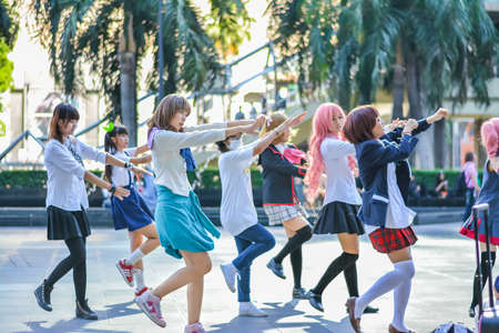 BANGKOK, THAILAND - MARCH 31: Group of Thai cosplayers dancing like cover girls for public show in the 3rd Thai-Japan anime festival on March 31, 2013.