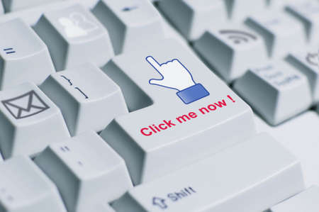 A finger sign saying  click me now  on the keyboard  This is fully social media era  photo