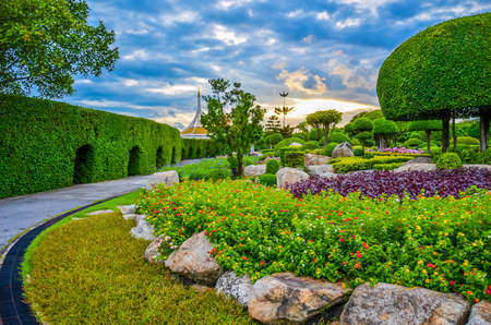 Dreamy park in Thailand, with beautiful flowers and sunset with illutionary scene