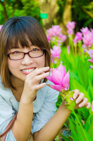 Cute Thai girl is very happy with colorful flowers in final retouch  She is smelling them with joy Stock Photo - 21058767