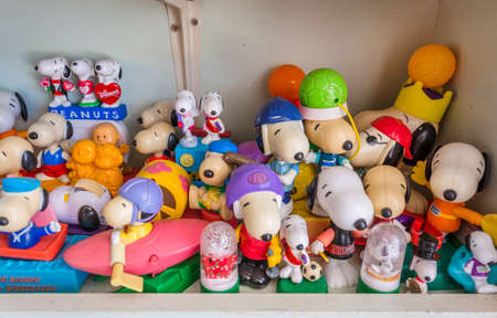 20 years old: BANGKOK, THAILAND - JULY 10: Various Snoopy toys collection from a Thai collector with over 20 years old on July 10, 2013. Snoopy is a fictional character in the long-running comic strip Peanuts, by Charles M. Schulz.