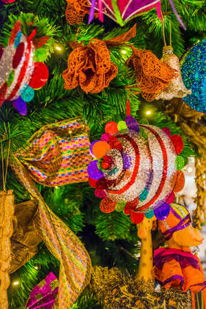 Colorful Christmas tree ornaments and decorations in night festival photo
