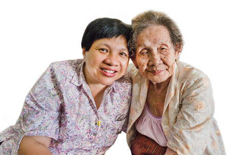 Family Portrait of an Asian elder mother and daughter hugging in isolated background photo