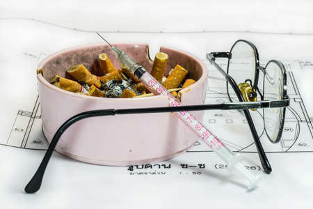 Ashtray, syringe, and glasses white blueprint representing stress in work concept