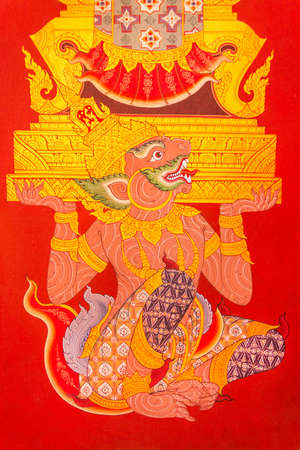 Ancient Mural painting of Hanuman lifting golden throne in Wat Dhammamongkol on June 8, 2013  Hamuman is a character in Ramayana legend