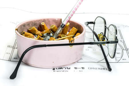 ashtray: Ashtray, syringe, and glasses white blueprint background representing stress in work concept  Stock Photo