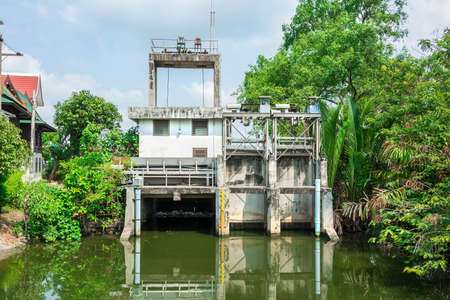 sluice: Water gate architecture in the rural canal of Thailand  It is use to release water at an appropriate level  Stock Photo