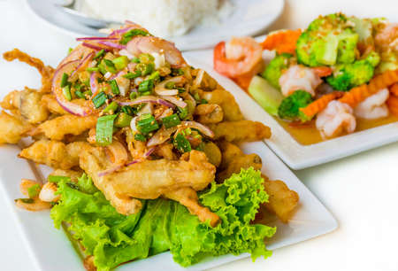 mingle: Spicy deep fried squid mingle serve with broccoli prawn salad  A delicious Thai cuisine lunch menu