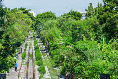 Landscape of an old railway across Thailand countryside in top view photo