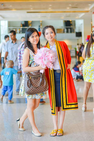 BANGKOK, THAILAND - 4 MAY 2013  Graduate Thai college student from King Mongkut s institution standing with her friend on May 4, 2014  King Mongkut s technology institution is a famous university in Thailand