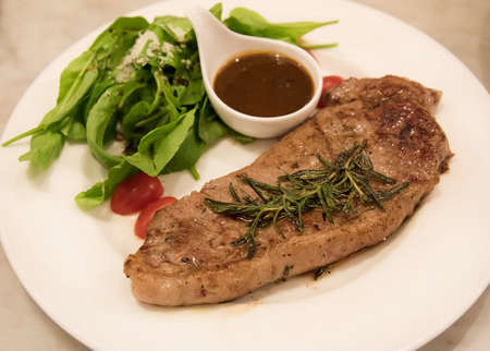 western food: Premium ribeye steak on a well decorated dish ready to serve