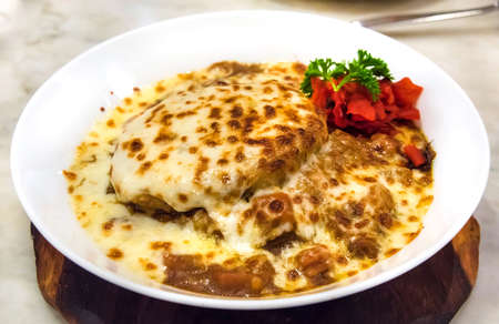 convergence: Creative Japanese curry with mozzarella cheese on top. It Stock Photo