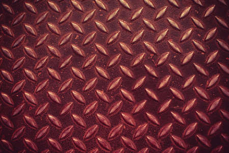 Red metal surface pattern background in grunge style photo