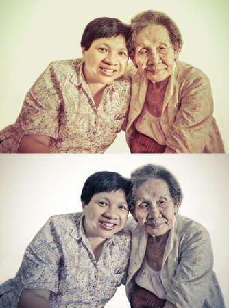 Family Portrait of an Asian elder mother and daughter hugging in isolated backgroud in retro color set photo