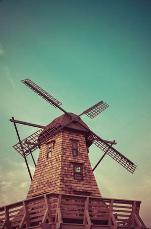 aero generator: Windmill standing in the blue sky creating a nice aerial view in retro color Stock Photo