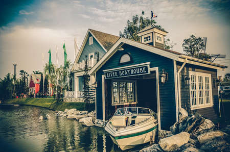 lifeboat station: Boat House beside the river in grunge retro style