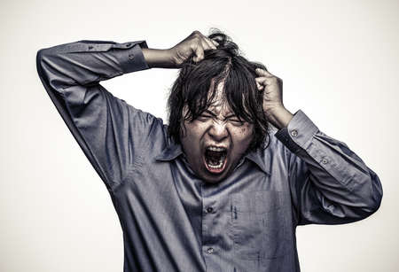 grain grunge: An Asian office guy is stressing to his limit in white background  in heavy grain grunge style Stock Photo