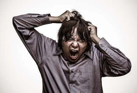 An Asian office guy is stressing to his limit in white background  in heavy grain grunge style photo