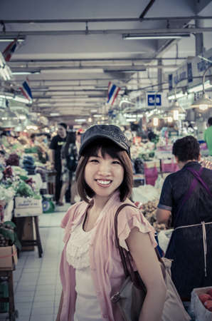 retailer: Active Asian girl tourism is touring in Thailand open market in vintage color Stock Photo
