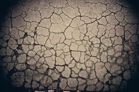 dry stone: Crack dry soil ground background in grunge color