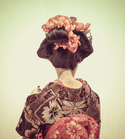 Backside of Japanese traditional doll of dancing Geisha with white background Stok Fotoğraf