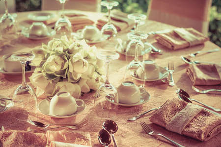 wedding party: Dining table preparation in a luxury restaurant in vintage color style