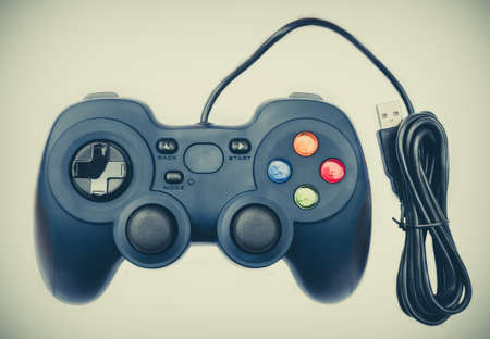 playing video games: Old black joystick for console video game in isolated background