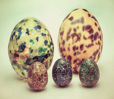 Group of ornate Easter eggs and various design in white backgrond in vintage color photo