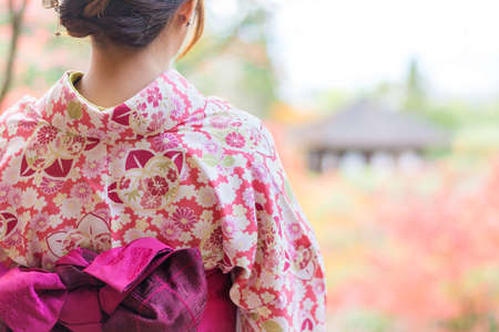 japanese culture: Back of a pretty Japanese girl in beautiful atmosphere. This picture has soft focus. Stock Photo